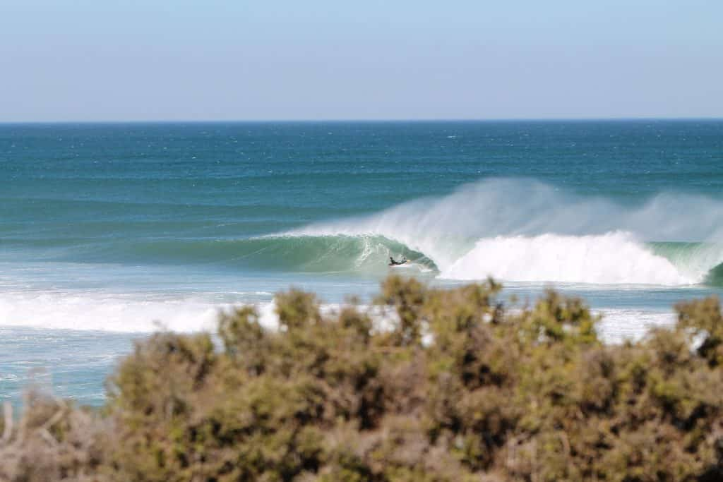 Bodyboard holiday in South Africa. Young man surfing wave.
